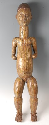 Lot A large carved wooden power figure in the form...