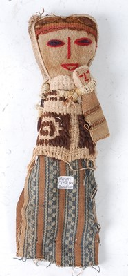 Lot A woven textile burial/funeral doll, in the...