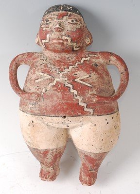 Lot A terracotta hollow form figure of a male in...