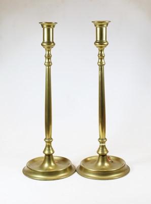 Lot 1 - A pair oflarge Victorian brass candlesticks,...
