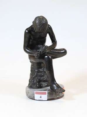 Lot 4 - A bronze figure of a boy, shown in seated pose...