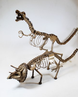 Lot 5 - A gold painted model of a dinosaur,...