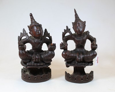 Lot 6 - A pair of 20th century Eastern carved hardwood...