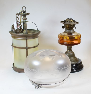Lot 7 - An early 20th century brass oil lamp, with...