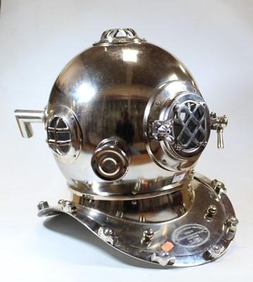 Lot 9 - A reproduction American Navy polished metal...