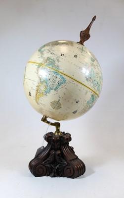 Lot 12 - A 20th century globe, mounted on a mahogany...