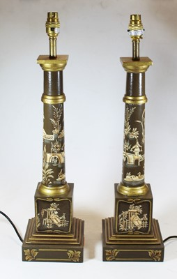 Lot 21 - A pair of reproduction turned wood table lamps...