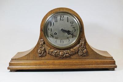 Lot 41 - An early 20th century oak cased 8-day mantel...