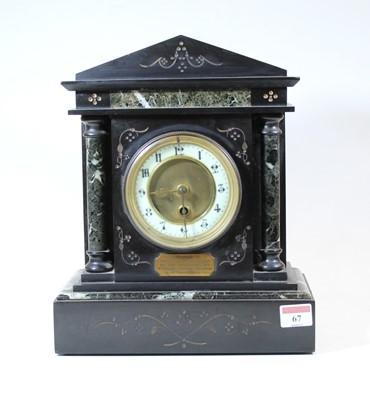 Lot 67 - A Circa 1900 black slate mantel clock, of...