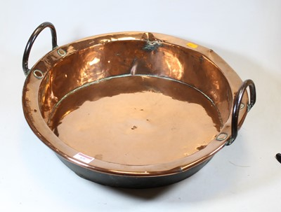 Lot 69 - A Victorian copper preserve pan, flanked by...