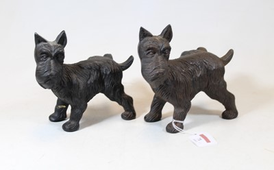 Lot 71 - Two cast iron models of Terriers, each shown...
