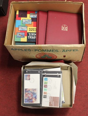 Lot 100 - A large collection of stamps, several housed...