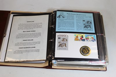 Lot 73 - An album of first day covers and medal covers...