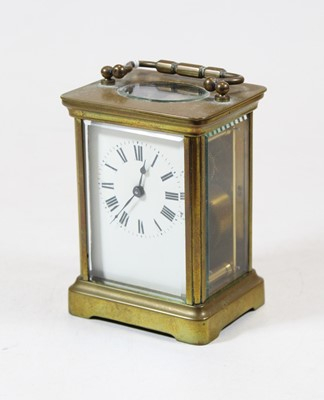 Lot 32 - A French lacquered brass carriage clock,...