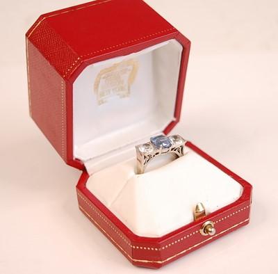Lot 3087 - A white metal, sapphire and zircon three-stone...