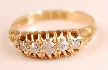 Lot 3097 - An 18ct yellow gold diamond five-stone half...