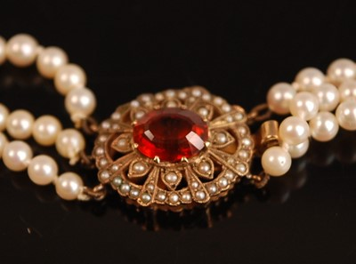 Lot 3095 - A three-row cultured pearl necklet, comprising...