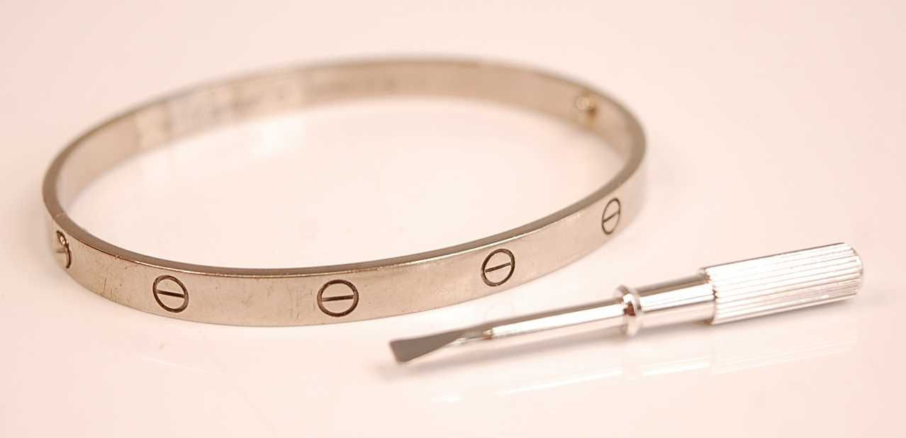 Lot 3084 - A Cartier 18ct white gold 'Love' bangle,...