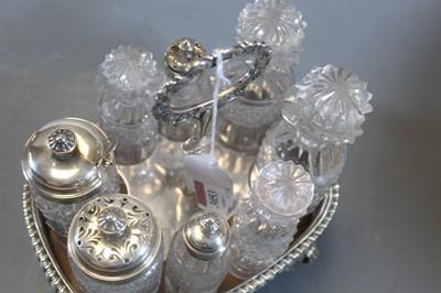 Lot 3053 - A George III silver eight-bottle cruet, of...