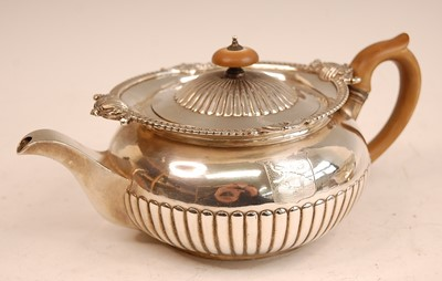 Lot 3054 - A George III silver teapot, of half-reeded...