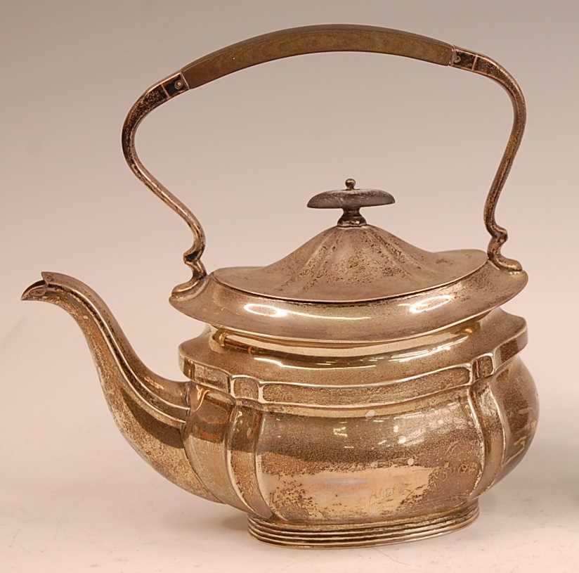 Lot 3056 - A George V silver tea kettle, having ebony...