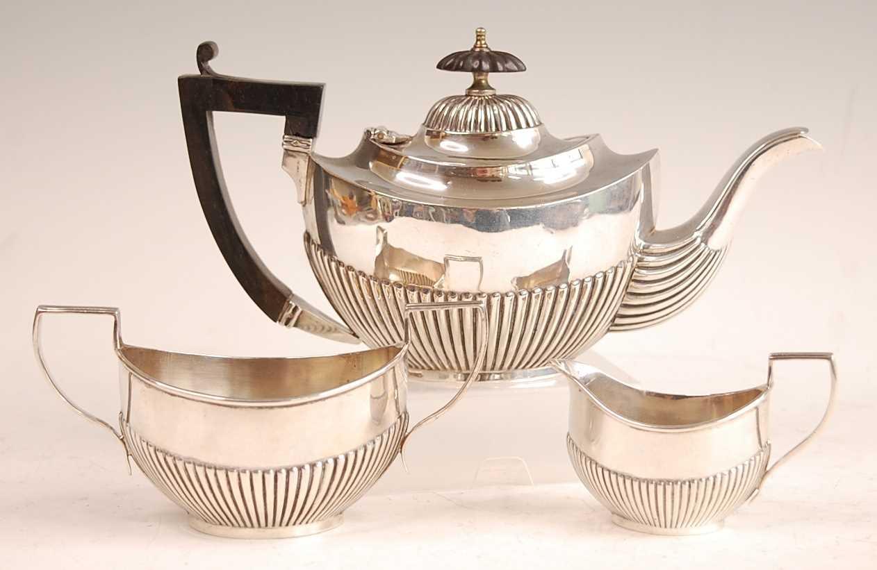 Lot 3072 - A George V bachelors three-piece silver tea...