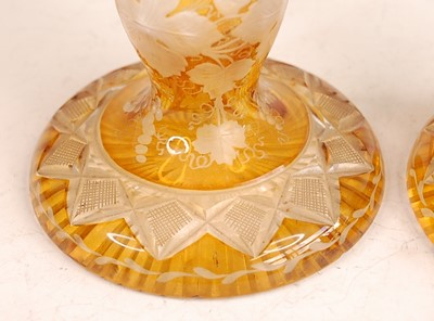 Lot 3043 - A pair of Bohemian cut and amber flash glass...