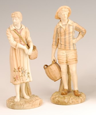 Lot 3034 - A pair of Royal Worcester blush ground figures...