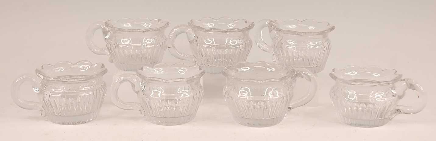 Lot 3047 - A set of seven William IV cut glass custard...