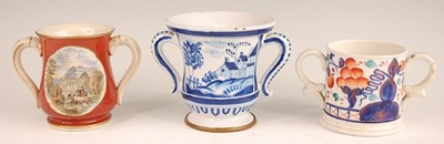 Lot 3024 - A Victorian prattware loving cup, the reserves...