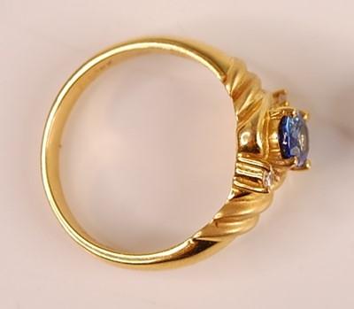Lot 3092 - An 18ct gold Ceylon sapphire and diamond set...