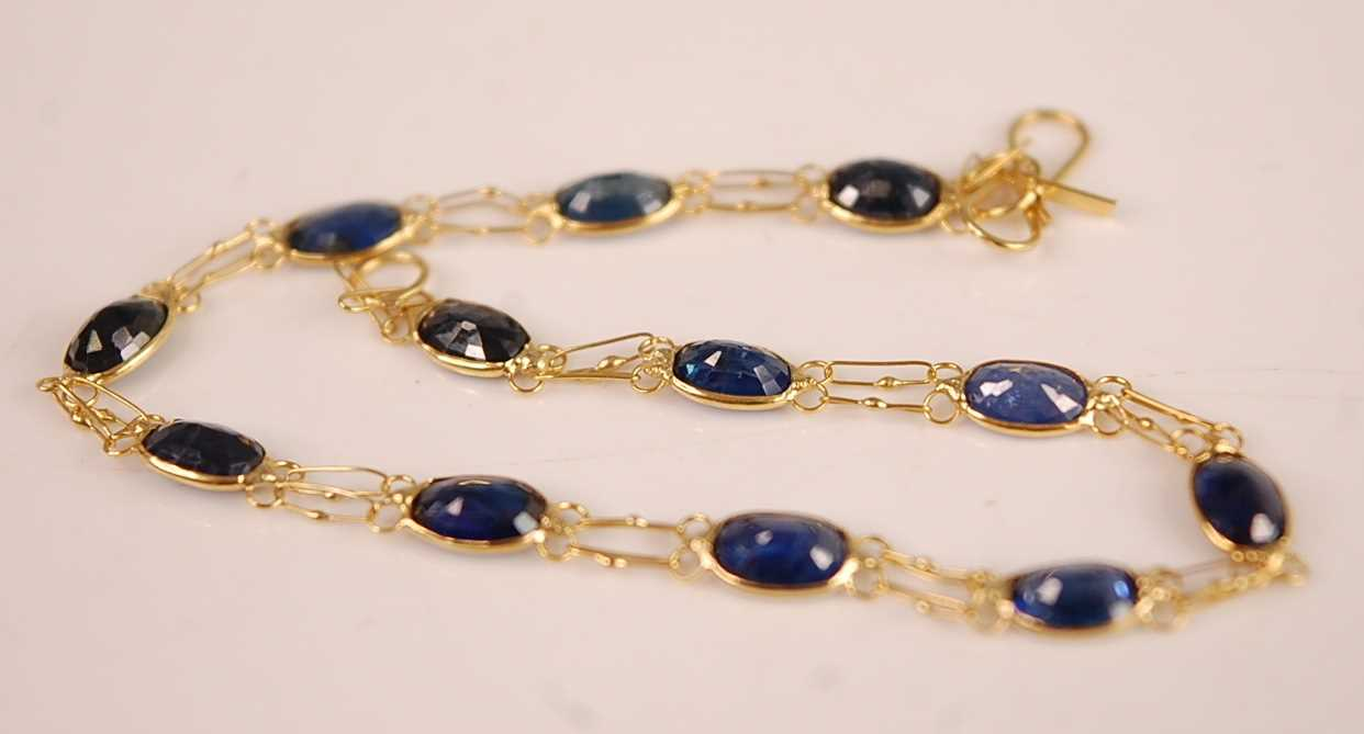 Lot 3090 - A contemporary yellow metal and sapphire set...
