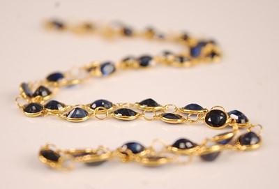 Lot 3091 - A contemporary yellow metal sapphire set...