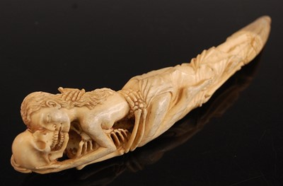 Lot A cow bone? model of a tusk, carved as a...