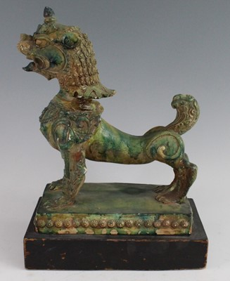 Lot 1 - A Chinese green glazed pottery figure of a Fu...