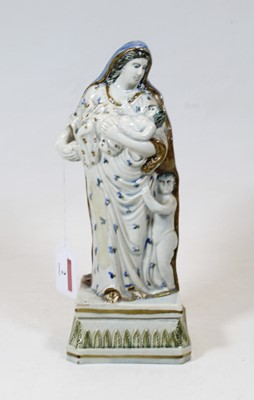 Lot 2 - A pearlware figure group of Charity, shown...