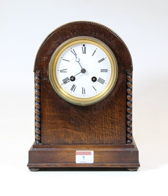 Lot 7 - An early 20th century oak cased eight-day...