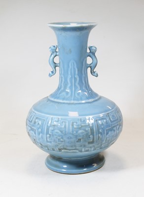 Lot 11 - A 20th century Chinese blue glazed vase, the...