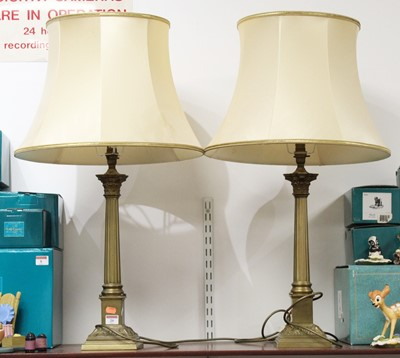 Lot 20 - A pair of 20th century brass table lamps, in...
