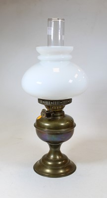 Lot 24 - A 19th century brass oil lamp, with milk glass...