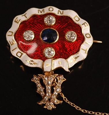 Lot 1088 - A yellow metal, sapphire and diamond enamel...