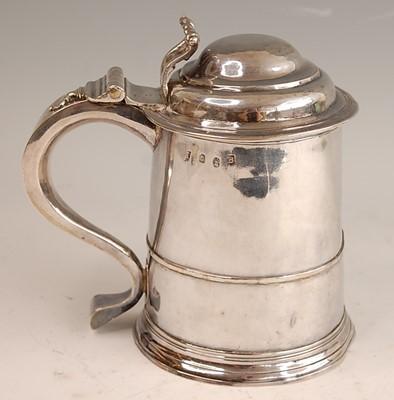 Lot A George I silver lidded tankard, of plain...
