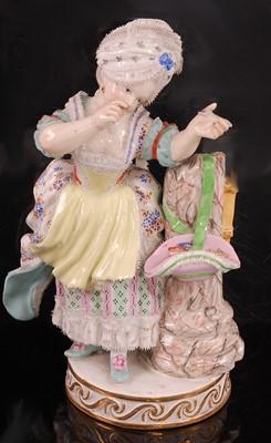 Lot 1015 - A 19th Century Meissen porcelain figurine of a...