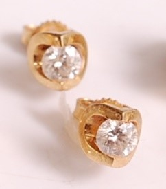 Lot A pair of 18ct yellow gold single stone...