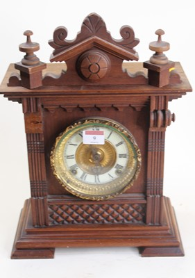 Lot 9 - An early 20th century carved walnut cased...