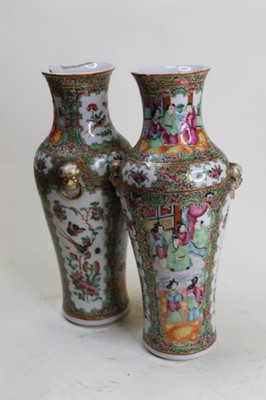 Lot 11 - A pair of late Qing Dynasty famille rose vases,...