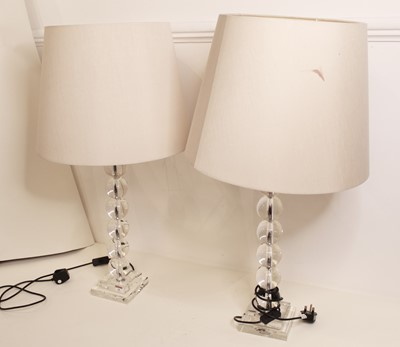 Lot 16 - A pair of modern glass table lamps, of beaded...