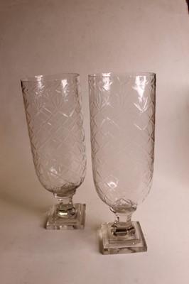 Lot 17 - A pair of modern cut glass storm lamps, each...