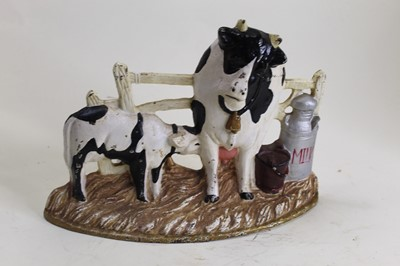 Lot 19 - A cast iron doorstop in the form of a cow and...