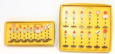 Lot 1011 - Two Dinky Toys sets of early road signs as...